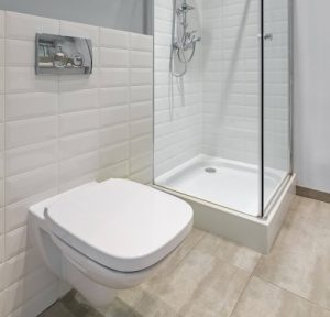 ensuite bath with white wall tiles and marble floor tiles in Whitburn