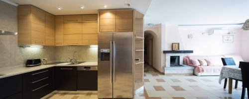 tiled floor kitchen and living room by Livingston Tilers